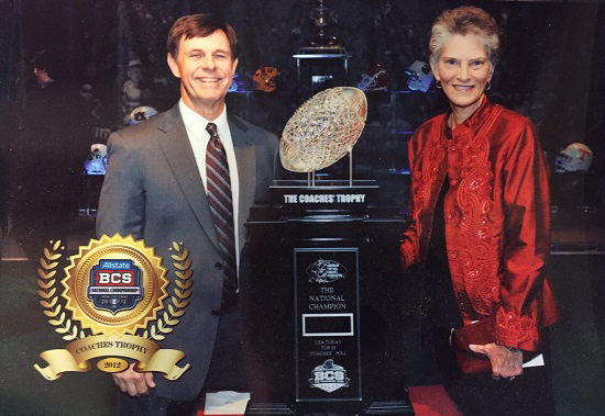 A photo of David and Sharon Hunt with the Coaches' Trophy.