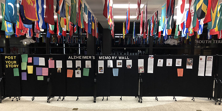 A photo of the temporary exhibit called the Alzheimer's Wall with notes left by campus members who knew friends and family affected by Alzheimer's disease.