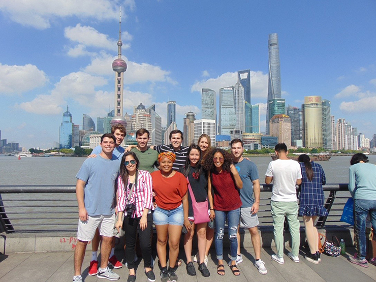 A photo of Shanghai with students in the foreground.