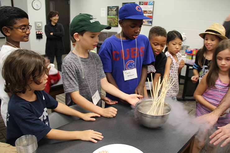 Students experiment with liquid nitrogen during a Summer STEM Camp.