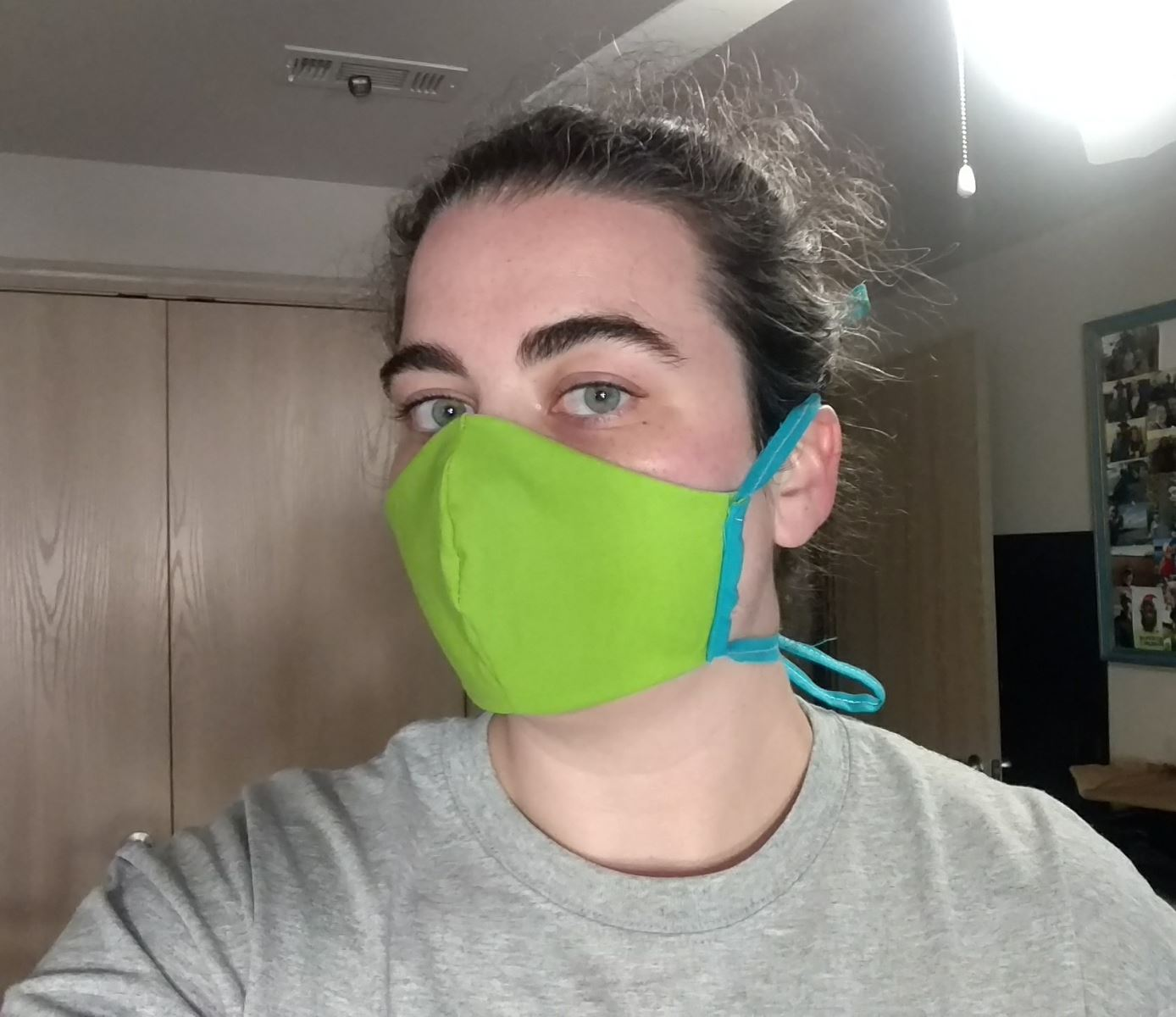 Shelby Fleming dons one of the masks she sewed.