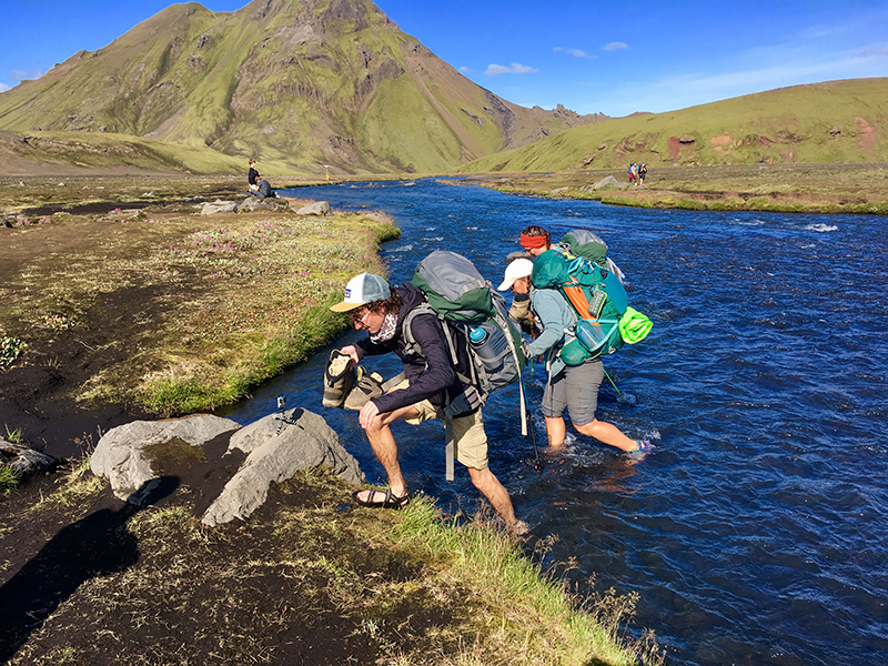 Carver Bomboy, Megan Turk and Becca Kilpatrick cross a river near Hvanngil, Iceland.