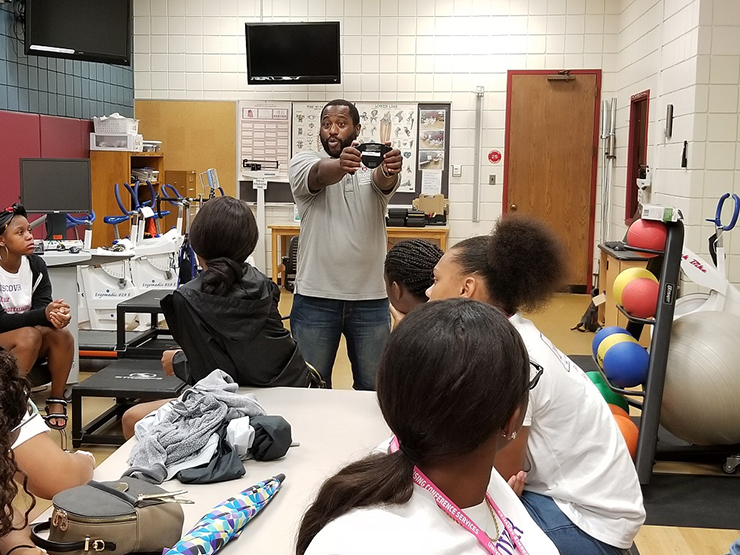 Tyrone Washington, associate professor of exercise science, leads campers through an exercise physiology lab.
