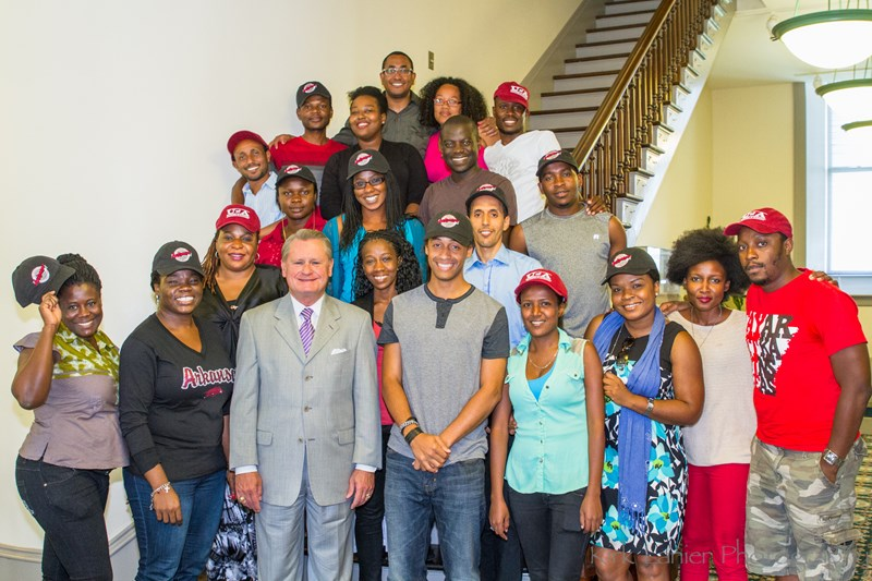 Fellows of the Young African Leaders Initiative gather with Chancellor G. David Gearhart on Monday for a group photo in Old Main at the University of Arkansas.