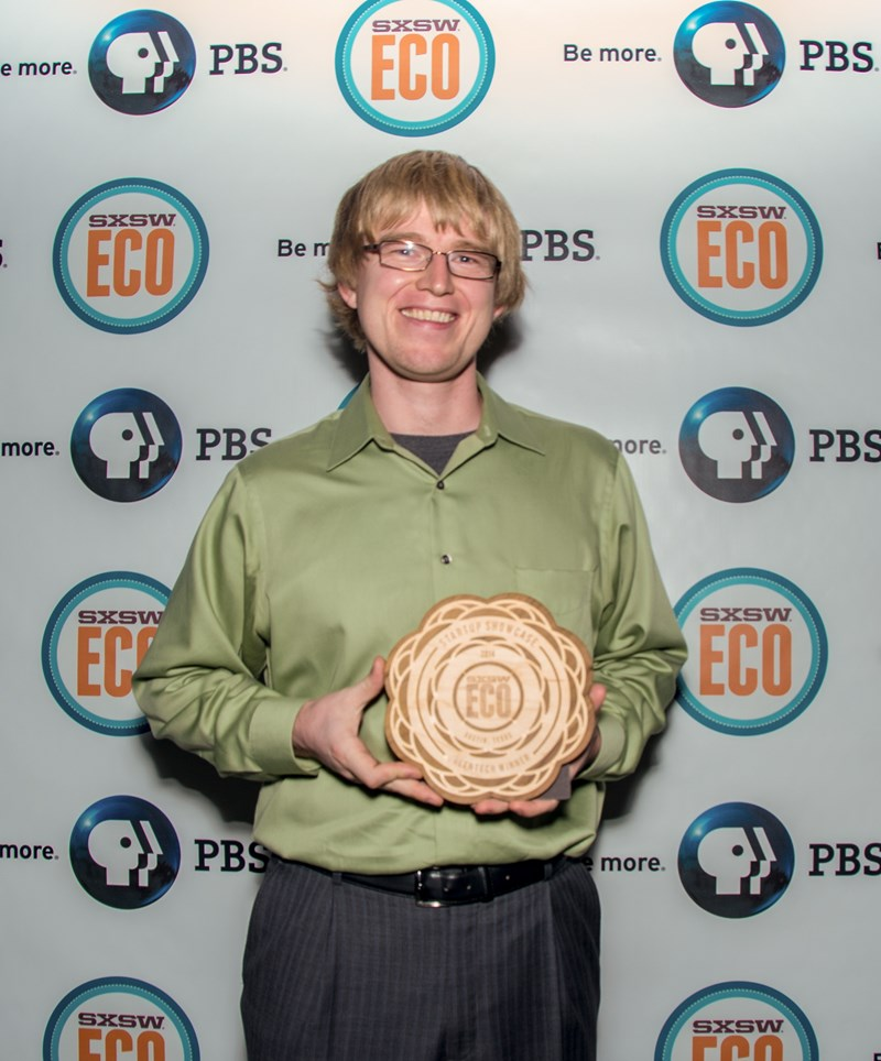 Douglas Hutchings, CEO of Picasolar, holds the Greentech first-place award at the SXSW Eco Startup Showcase
