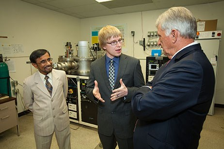 Douglas Hutchings (center), CEO of Picasolar Inc., explains the start-up company's technology to Arkansas Gov. Mike Beebe after Picasolar's sister company received a SunShot Incubator Award. Hameed Naseem, a professor of electrical engineering, is on the left.