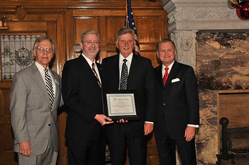 From left to right, Jerry Adams, Alan Mantooth, Governor Mike Beebe, Chancellor G. David Gearhart