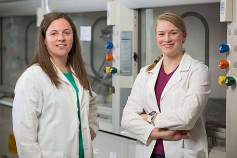 University of Arkansas graduates McKinzie Fruchtl (left) and Ellen Brune form the core of the start-up company Boston Mountain Biotech.