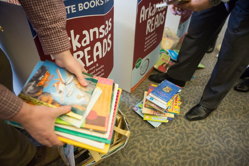 Members of Advancement Division donate books to Arkansas Reads