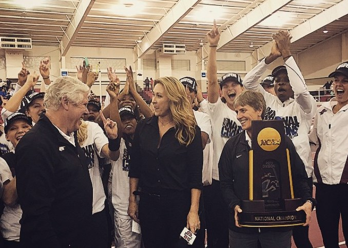 Coach Lance Harter and the women's track and field team receive the National Champions trophy Saturday.