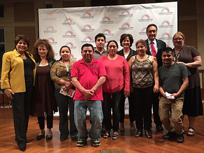 Henry Cisneros, Janet Murguia and Monica Lozano visit with community members.