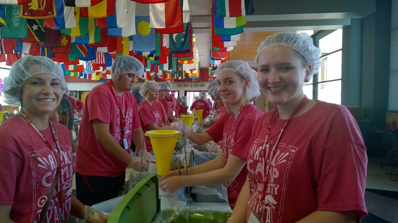 Students participate in a volunteer effort at the Arkansas Union to package food supplies.