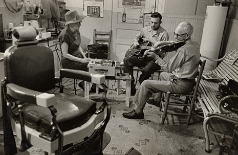 Mary C. Parler (left) tape recording musicians in Oriole barbershop, Bentonville, Arkansas, ca. 1950s. From the Mary C. Parler Photographs Collection (MC896) at the University of Arkansas Libraries Special Collections.