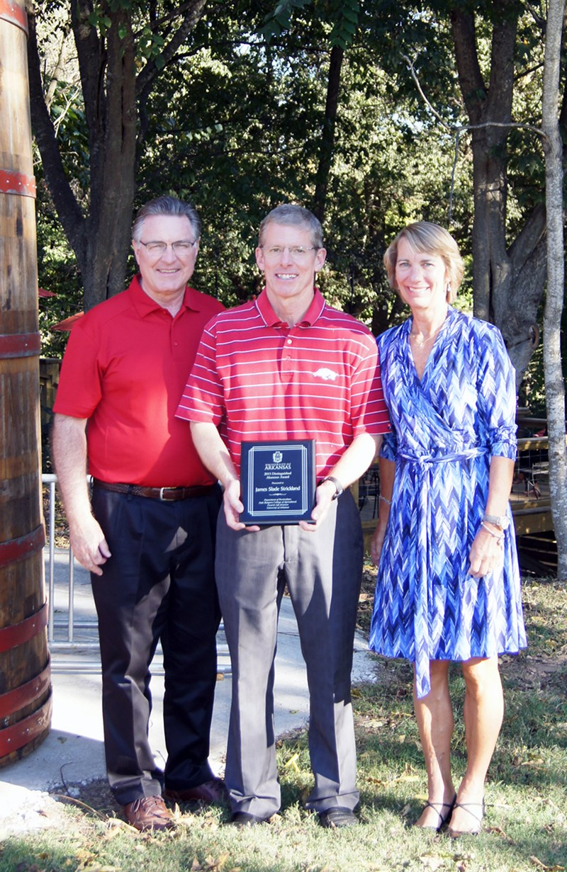 Slade Strickland, center, and his wife Elizabeth accept the 2015-16 Horticulture Department Distinguished Alumnus Award from department head Wayne Mackay.