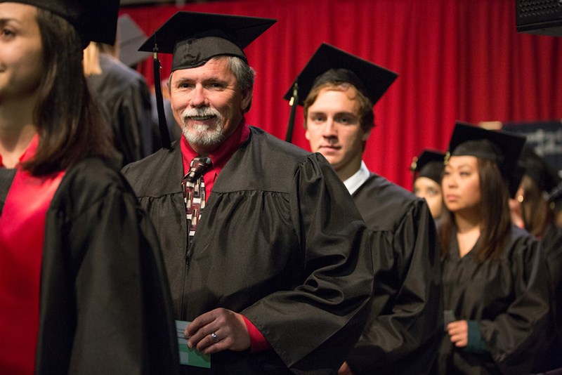 Norman Whitmore from Piedmont, Alabama (left) participated in fall 2014 commencement exercises after applying for graduation from the bachelor's degree in Human Resource and Workforce Development program.