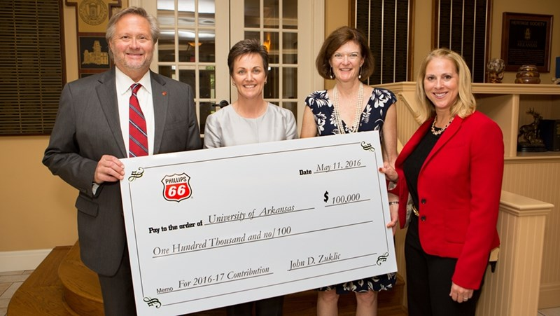 Dean John English, Associate Dean Anne O'Leary-Kelly and Assistant Vice Chancellor for Development Katy Nelson-Ginder accept a check from Phillips 66 during their recent campus visit.
