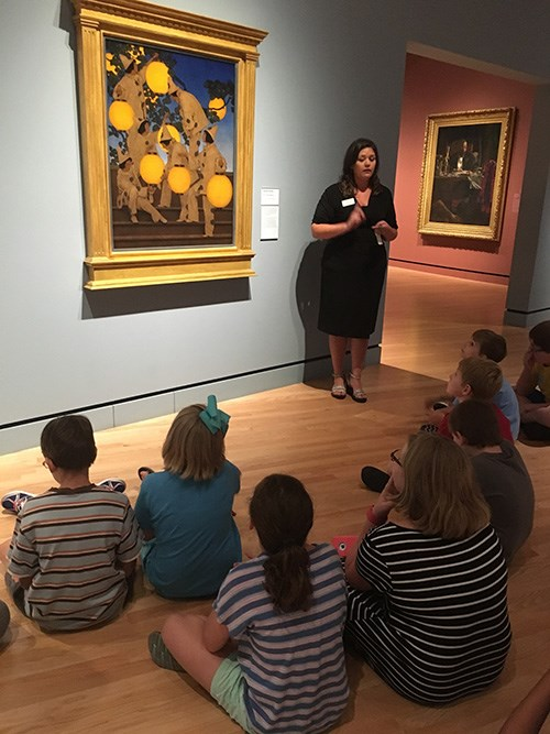 Emily Rodriguez talks about artwork with participants of Camp Connect at Crystal Bridges Museum of American Art.