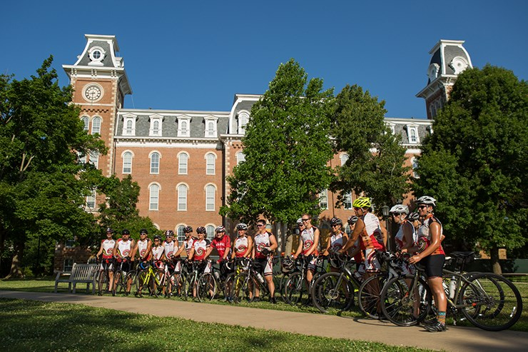 Cherokee bicyclists on the 'Remember the Removal' cross-country bicycle ride pause for a photo in front of Old Main earlier this year.
