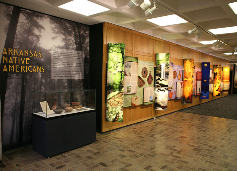 The Arkansas Native American exhibit stretches across a hallway on the 4th floor of the Arkansas Union.
