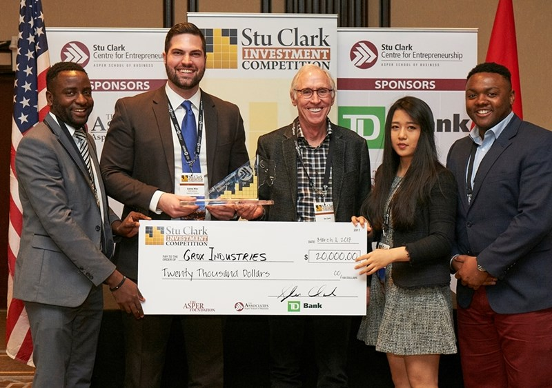University of Arkansas entrepreneurship team Grox Industries with oil and gas entrepreneur Stu Clark, at the University of Manitoba's Stu Clark Investment Competition. From left to right: Witness Martin, Andrew Miles, Stu Clark, Qiuting Zheng, Willie Evans.