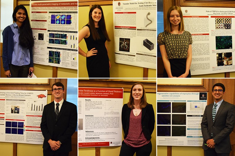 Biomedical engineering students with their research posters.