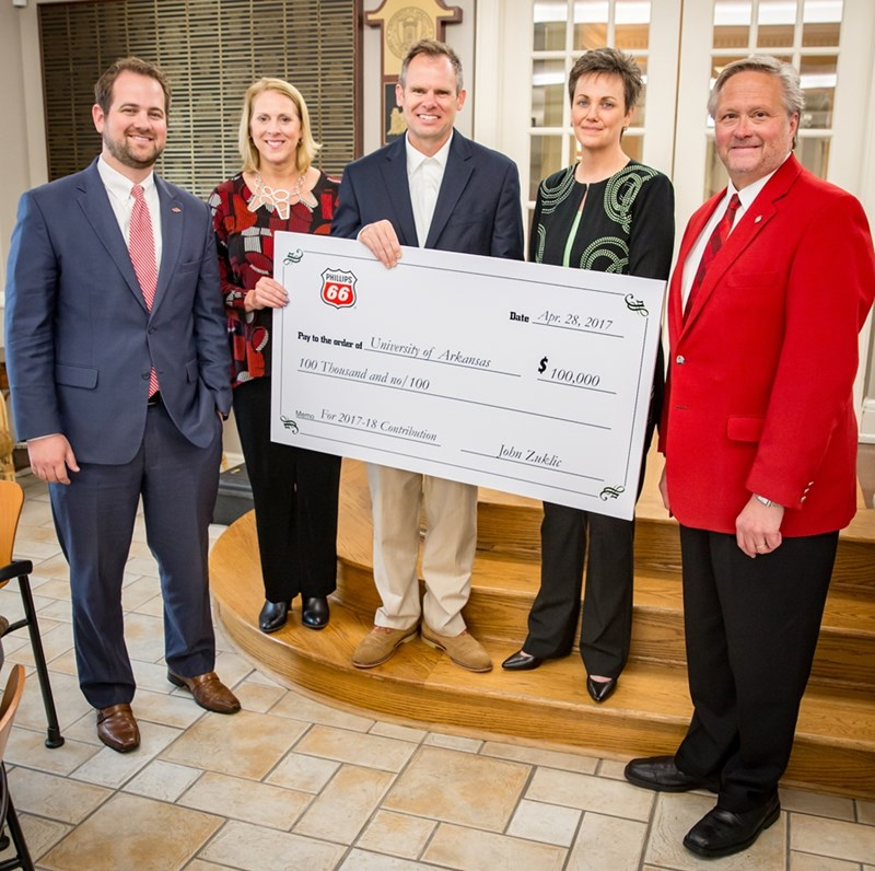 University representatives (from left) Todd Clark, Katy Nelson-Ginder, Gary Peters and John English accept a check from Pam McGinnis (second from right) on behalf of Phillips 66.