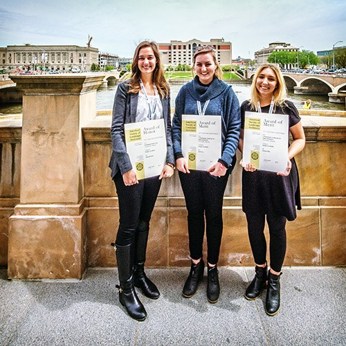 Hannah Moll, Erin Cox and Jordan Pitts show off the awards they received from the Central States Region of the American Society of Landscape Architects, during the conference in Des Moines, Iowa, in April.