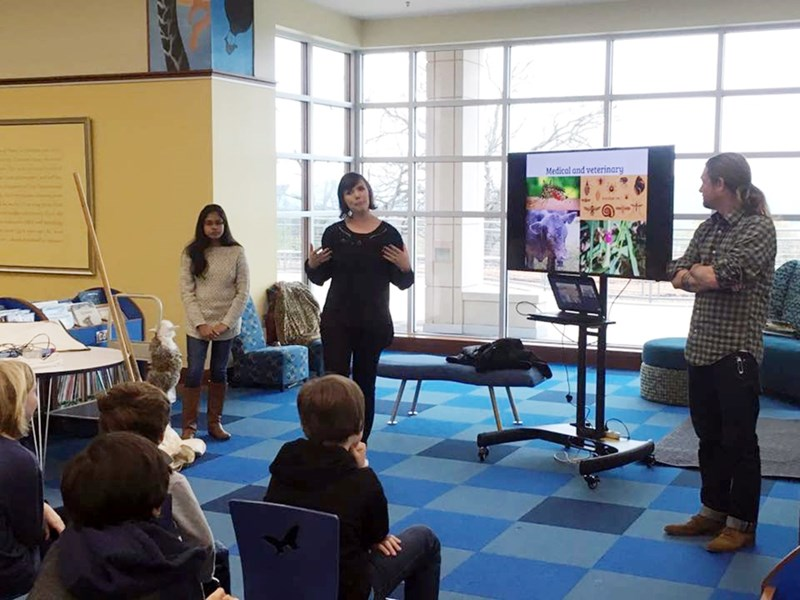 Bumpers College graduate students (from left) Janithri Wickramanayake, Krista Pike and Stephen Robertson from the Isley-Baerg Entomology Club talk to young students at the Fayetteville Library about insects and careers in entomology.