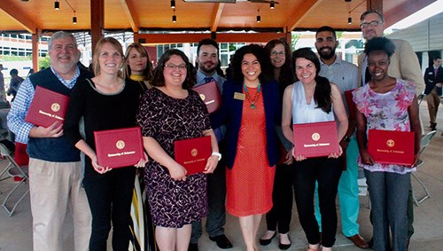Graduates of the Arkansas Teacher Corps program celebrate the completion of their Fellowship with Mireya Reith, center, chair of the Arkansas State Board of Education.