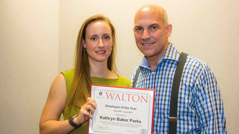 Kathryn Baker Parks receives a certificate of appreciation from Dean Matt Waller