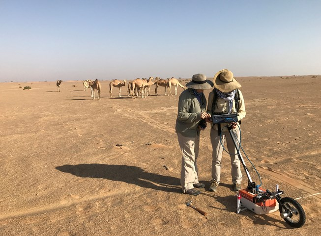 Researchers Katie Simon and Jennie Sturm use the SIR 3000 with 400 MHz antennas to map an iron metalworking site in western Oman.