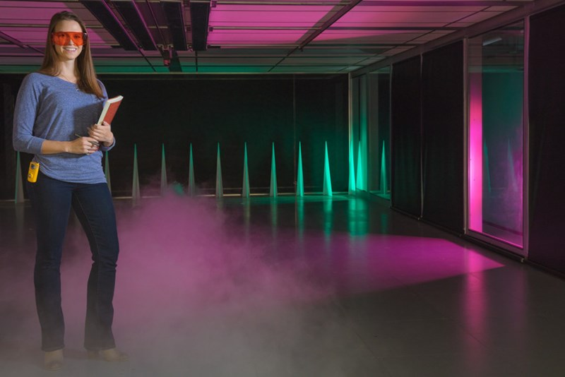 Jessica Morris in the world's largest ultra-low-speed wind tunnel at the U of A's Chemical Hazards Research Center.