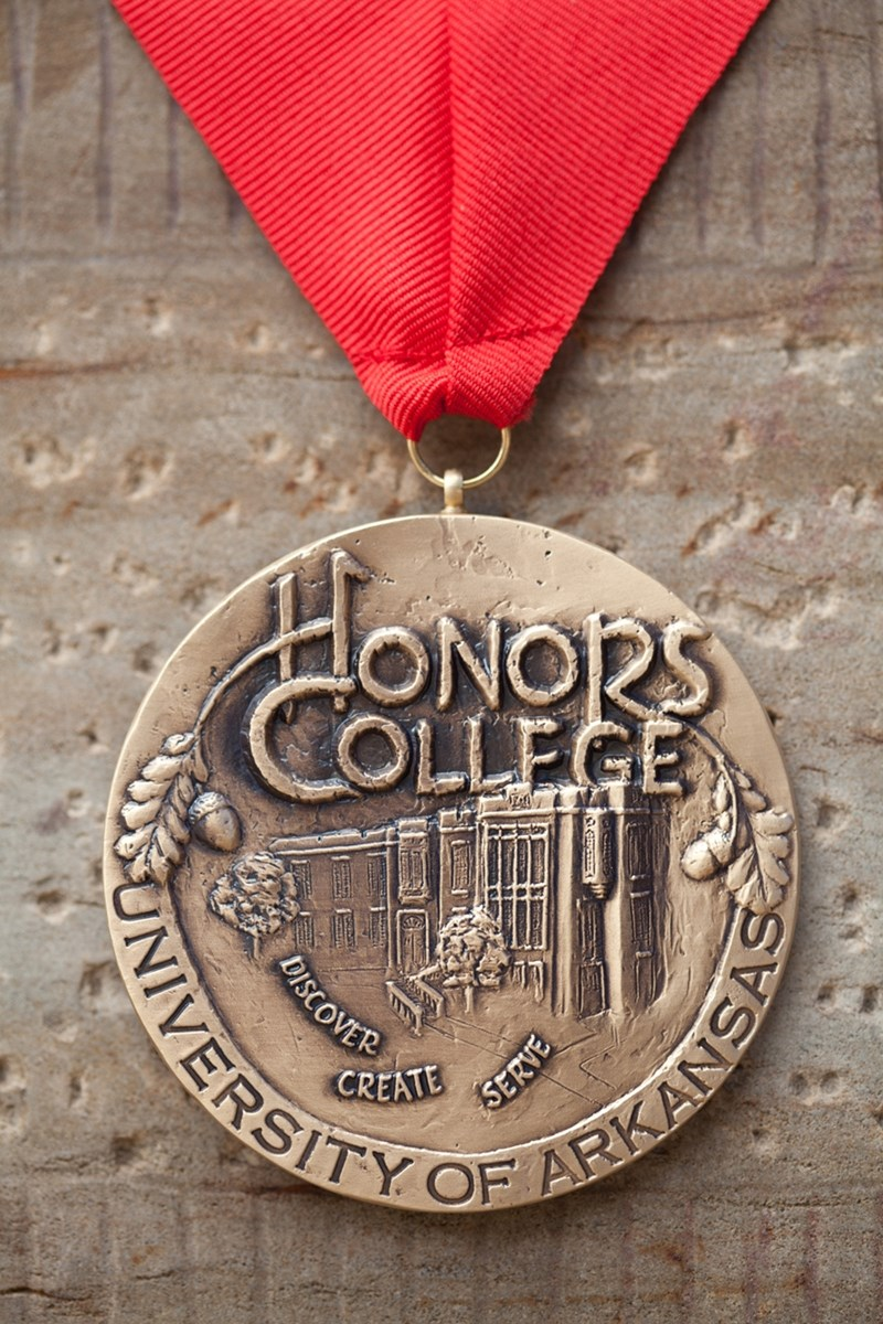Each of the Honors College Faculty award winners will receive this bronze medallion, which was sculpted by honors alumnus Hank Kaminsky.