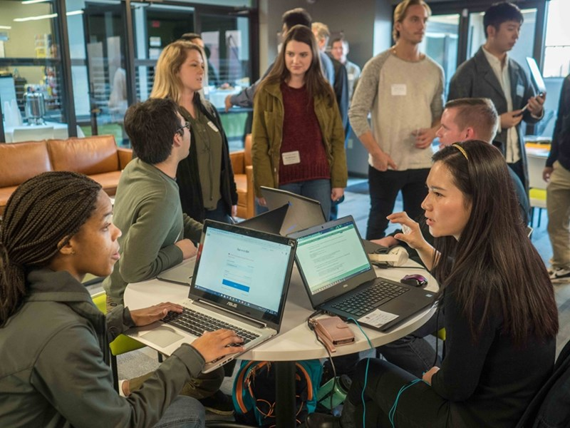 Students work across disciplines to solve industry challenges at the Walton College's first Blockchain Hackathon.