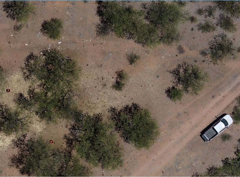 Aerial survey imagery taken from an elevation of 75 meters reveals cattle bones and other abandoned items.
