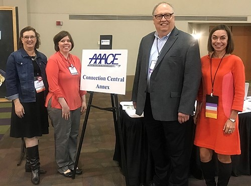 University of Arkansas faculty and staff members, from left, Vicki Dieffenderfer, Shelly Walters and Kenda Grover are pictured with Ralph Brockett, professor of adult education at the University of Tennessee, second from right.