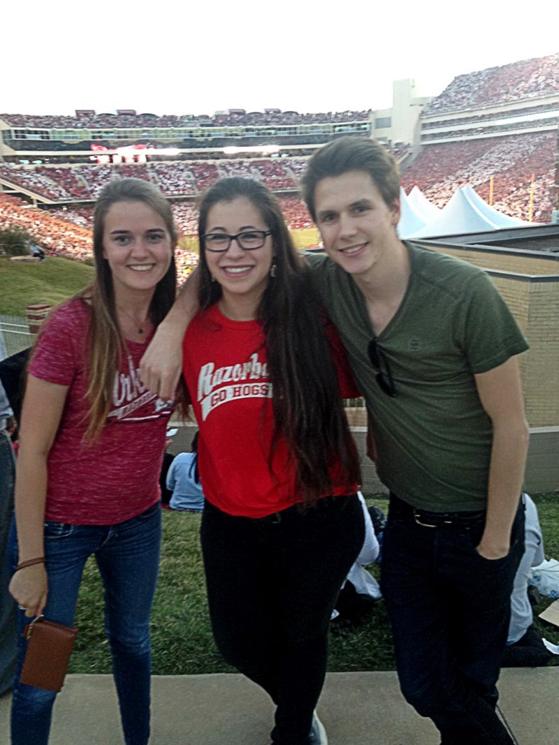 From left, Emma Maetens, Eva Dehaene and Flor Maes, all Bumpers College food science students from Ghent University in Belgium, at a Razorback football game last fall.