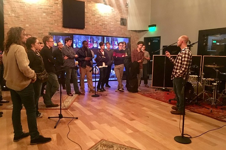 Several undergraduate students from the U of A's Department of Music visit Haxton Road Studios to meet Neil Greenhaw, right, the studio's owner and a professional sound engineer, producer and studio musician.