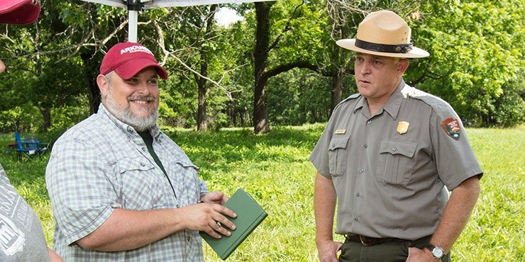 Jamie Brandon, station archeologist at Fayetteville, talks with Kevin Eads, superintendent of the Pea Ridge National Military Park during archeological work at the Civil War site.