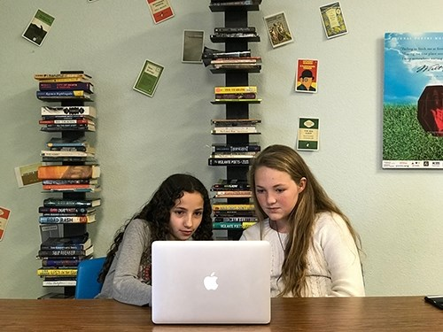 Students Kiersten Lima and Abby Best work on a podcast called All Girls Considered.