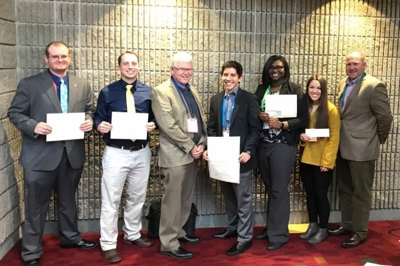 From left: Poultry science students Craig Maynard, Joshua Deines, Guillermo Tellez, Paula Johnson and Brittany Graham won research presentation awards at this year's IPPE trade show. They are pictured with Mark Cochran (center), UA Division of Agriculture vice president for agriculture, and Mike Kidd (right), poultry science department head and director of the Center of Excellence for Poultry Science.