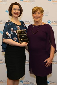 Kalie McKinley, left, receives her award from Fran Cleland, past president of SHAPE America.