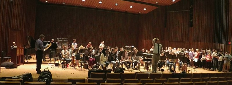 Wind Ensemble and Collegiate Chorale in rehearsal for the Grainger work.