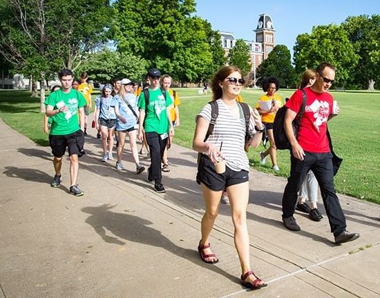 Design Camp students and instructors leave campus for a walking tour of downtown Fayetteville, city trails and the farmers' market during the 2017 summer camp.