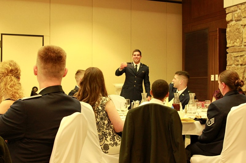 Cadet Andrew Peterson toasts the audience during the Grog Ceremony.
