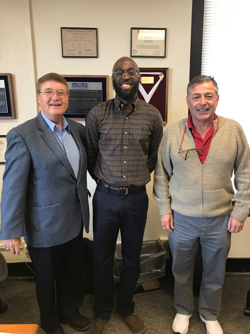 Zachery Hill, center, with professors Greg Parnell and Juan Balda after successfully completing the comprehensive exam.
