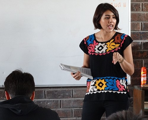 U of A graduate Marisa Buller teaches students in her intensive English class.