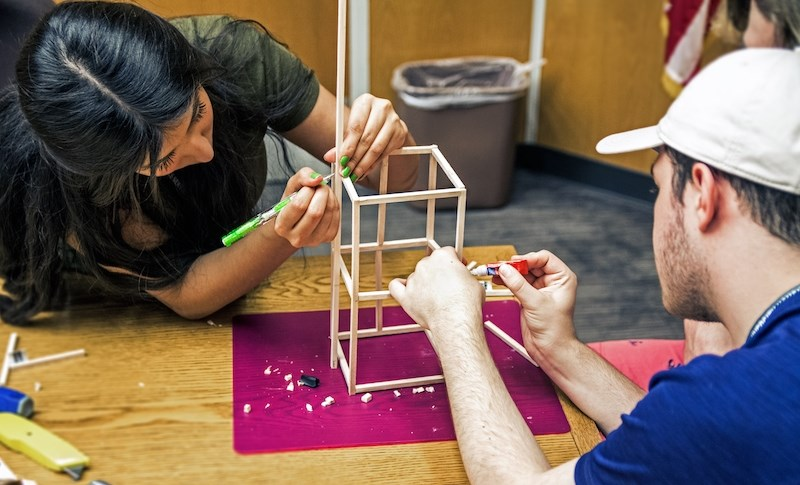 "Engineering Summer Academy participants build balsa wood towers as part of the ""Structure and Function"" track."
