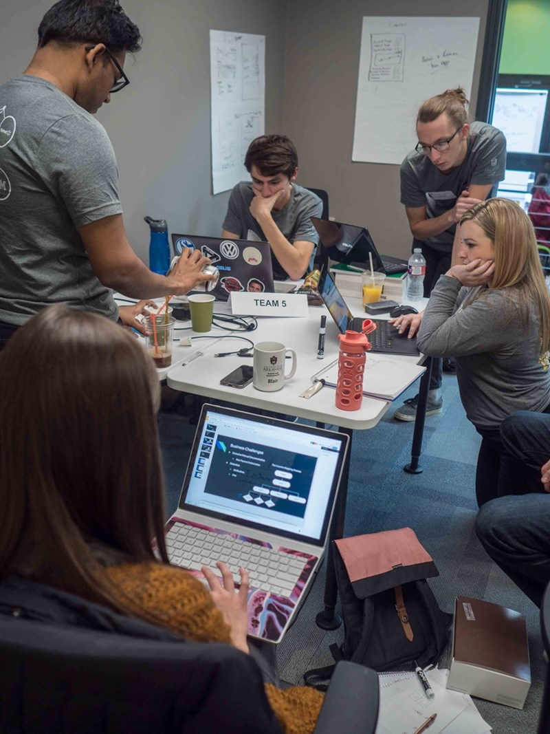 Students work on innovative solutions to real-world use cases during the 2017 Blockchain Hackathon.