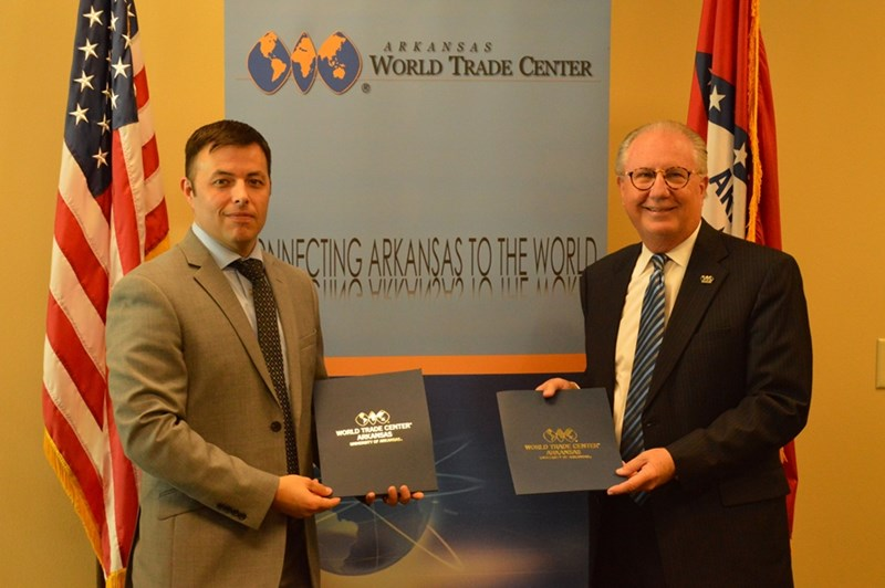 Small Business Administration Arkansas District Director Edward Haddock (left) stands with World Trade Center Arkansas President and CEO Dan Hendrix (right) after the signing of the Strategic Alliance Memorandum on Wednesday, October 10, 2018. Small business concerns make up nearly 80 percent of all exporting companies in Arkansas and are a key component of the state's economy.